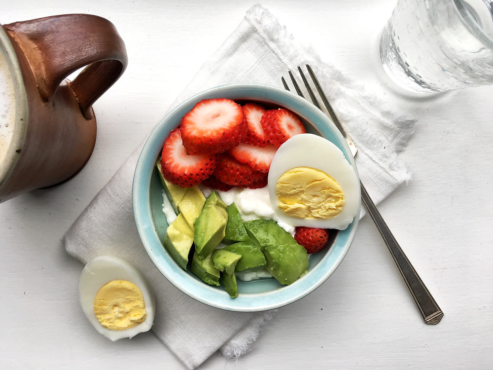 Cottage cheese bliss bowl with egg, avocado and strawberries.
