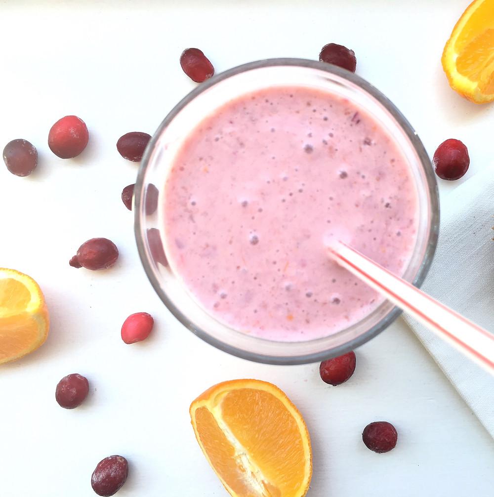 Vibrant Orange Raspberry Smoothie