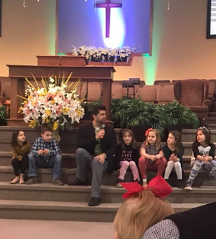 Ken with kids at church
