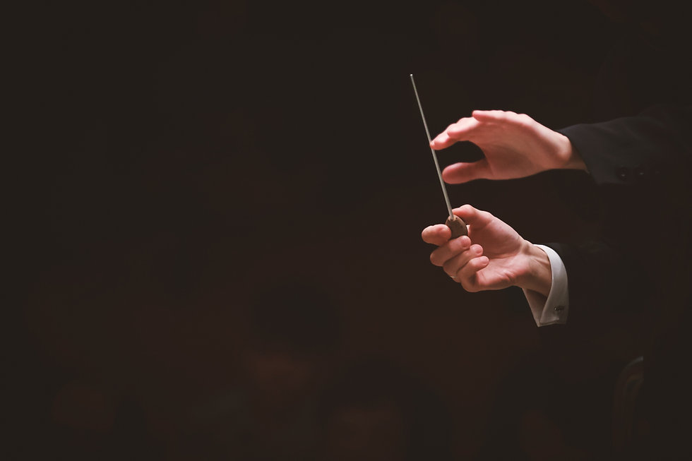 Cropped Image Of Conductor In Orchestra