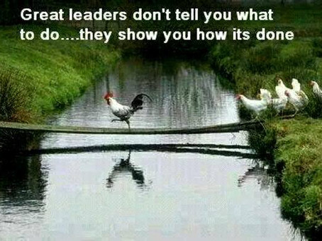 Do great leaders lead from the front or behind?