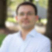 headshot of Krzysztof Dembek