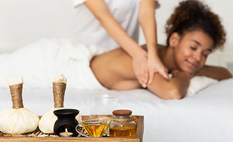 Body Care. Afro Woman Relaxing In Spa Sa