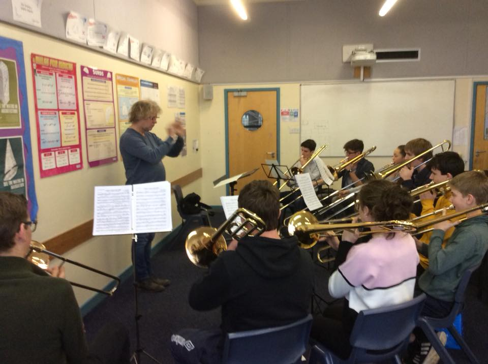 Piet takes trombone sectionals for their feature in I Will Follow Him