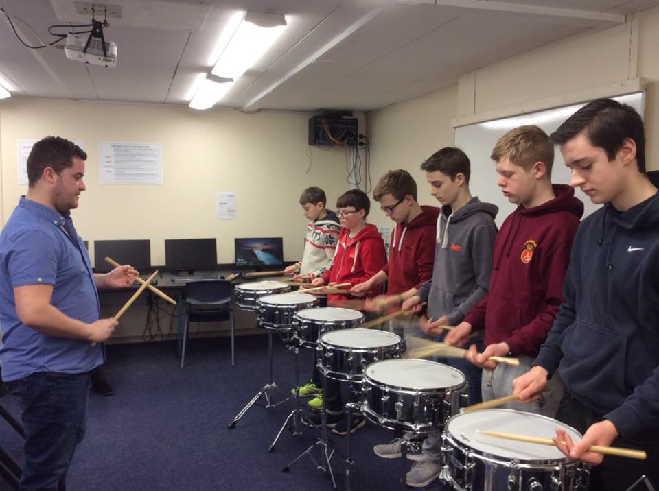 Max Ireland passes on his percussion expertise, practicing for a percussion feature for Music For Youth