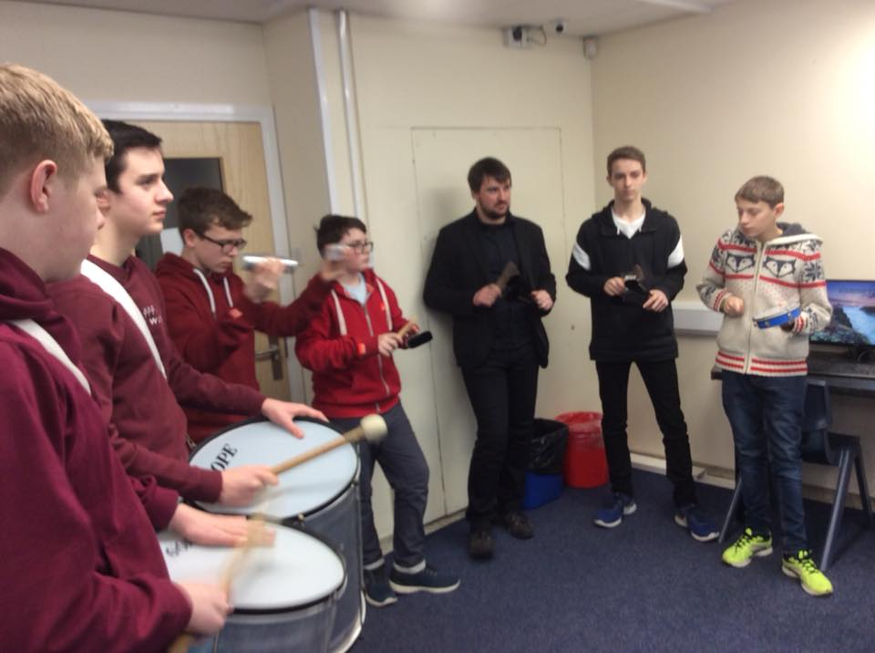 Laurynas passes on his percussion skills to GYBB members