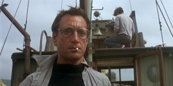 scene from Jaws: Chief Brody on boat with cigarette in mouth looking very frightened