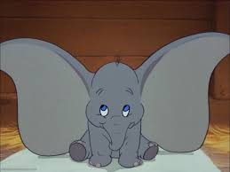 dumbo the elephant sitting on the floor with his ears out wide