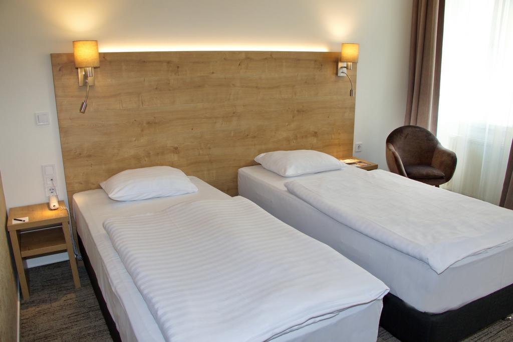 Fotografia de la habitacion del City Hotel Ring en Budapest