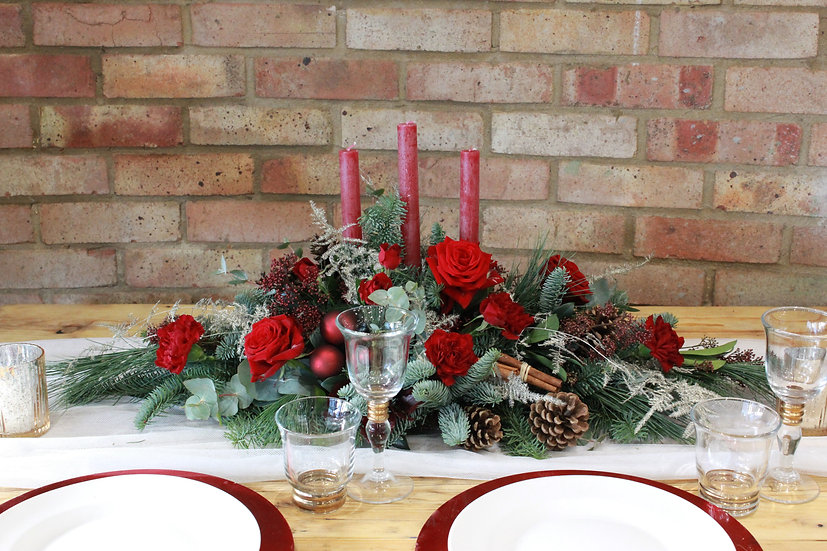 Christmas Table Flower Arrangement With Candle Sticks