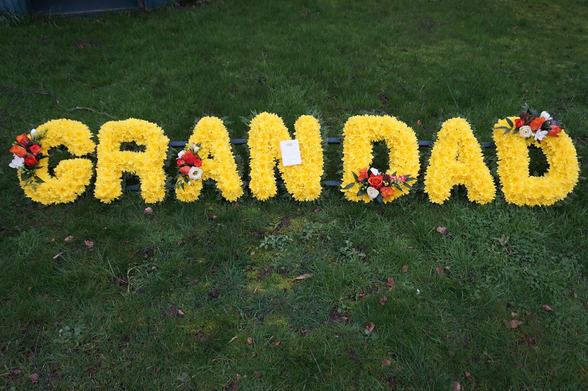 Personalised 'Lettering' Tribute with yellow base, leaf edge & Spray