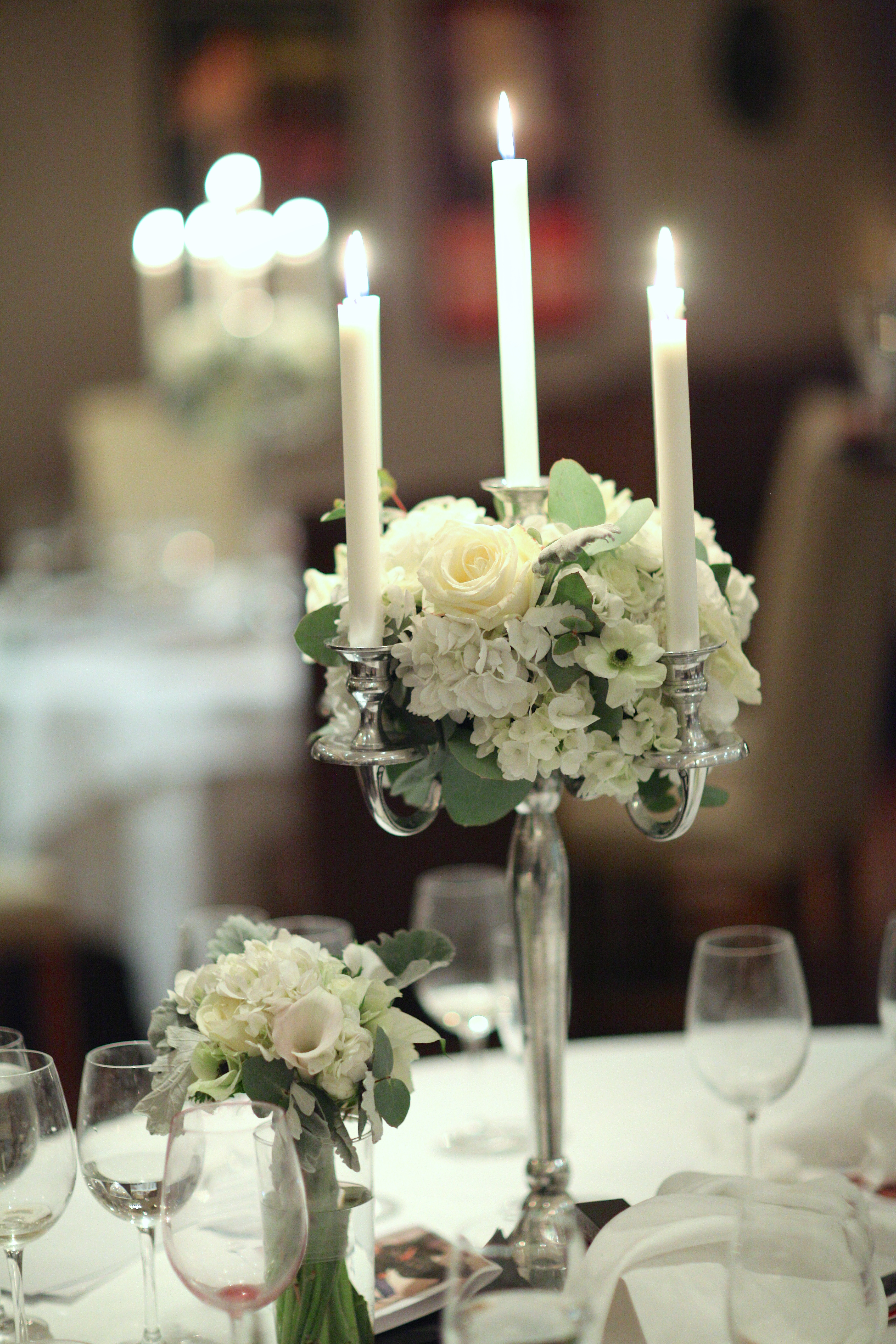 Candelabra dressed with roses, hydrangea, anemones and lisianthus