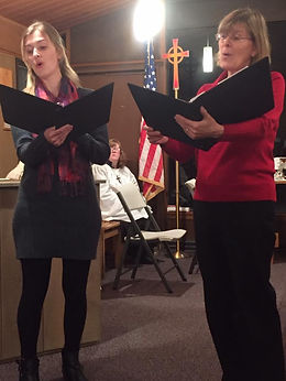 Sarah Gettel and Jenny Gettel sing during a Christmas Eve service