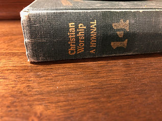 "The spine of a book titled ""Christian Worship: A Hymnal"""