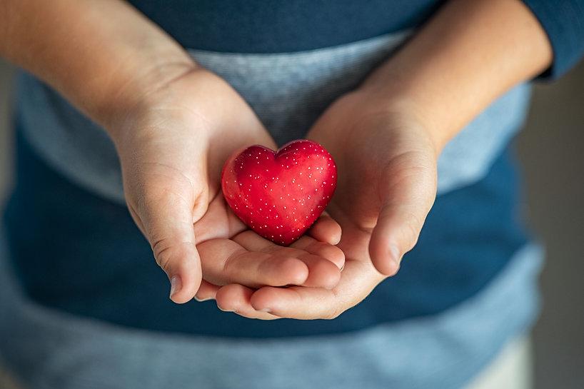 child-holding-red-heart-in-his-little-hands-2021-08-28-15-25-53-utc.jpg
