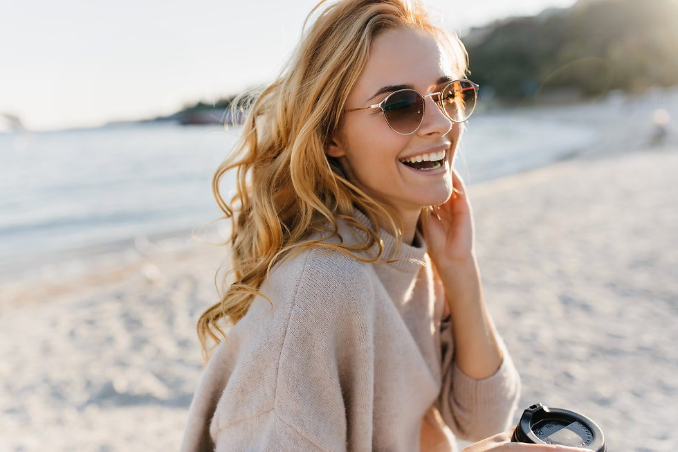 Cute woman genuinely laughs, relaxing on