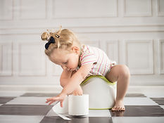 funny child girl sitting on chamberpot.j