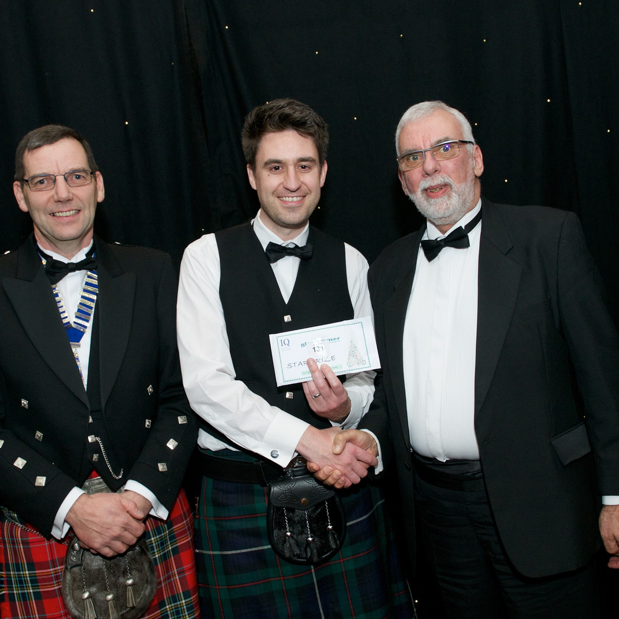 Glenammer Director Allen Matthews and Scottish Branch of IQ Chairman Andrew Gillon awarded a Star Prize to (£750 John Lewis vouchers) to Kris Bremner, of Breedon Group