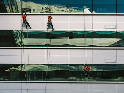 workers on side of building