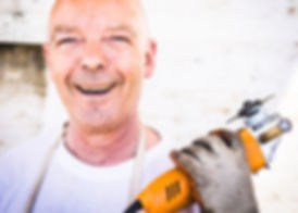 worker smiling with tools