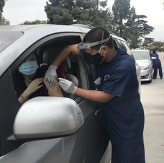 Registered Nurse Rupert administering a flu vaccine