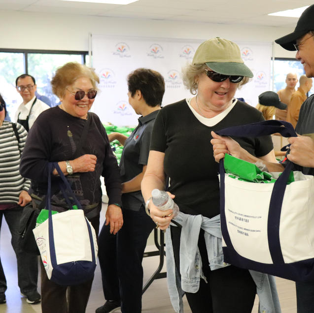Councilmember Sean Dang personally gifting the tote bags to Rosemead residents