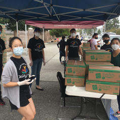 Volunteers ready to distribute frozen meat for households