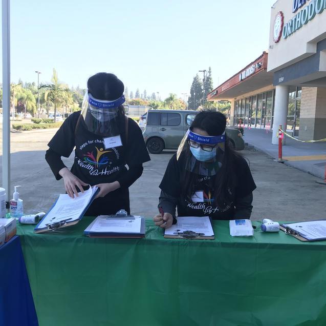 Volunteers prepping patient registration forms.