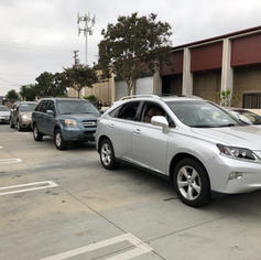 Cars in an orderly line for a flu vaccine
