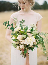 This is a beautiful country wedding of roses, dahlias, snowberries, queen anns lace, and pepperberrie set in a farming field near Oceanside Oregon