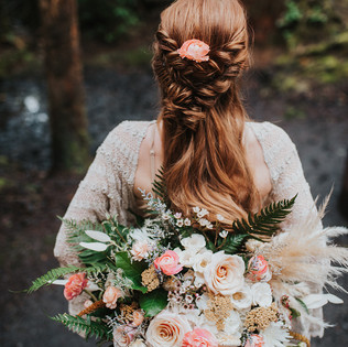 large boho bridal bouquet of coral peach and blush flowers