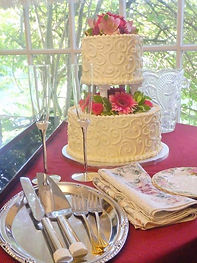 Wedding cake at Sandlake Country Inn Flowers by Anderson Florists Cake by Sara Sota's Tillamook Pacific City Oregon