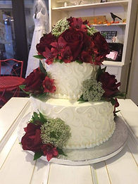 Black Magic roses and queen Anns lace adorn this wedding cake made by Sara Sota's Tillamook Oregon Flowers by Anderson Florists Tillamook Oceanside Rockaway Beach Nehalem Manzanita Pacific City Oregon