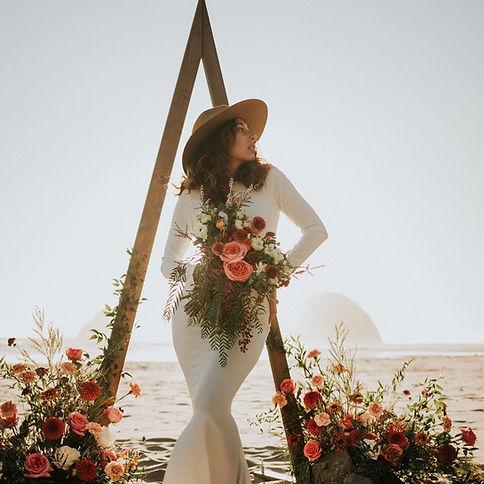 Oregon coast elopements boho triangle arbor oceanside rust and blush flowers