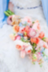presitation bridal bouquet with peach and light blue flowers weddings by anderson florist Tillamook