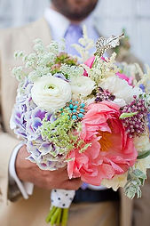 spring mix of peonies, ranuculas, hydrangea, queen anns lace embelished with a tiffany blue brooch make up a beautiful spring bridal bouquet in Tillamook Oregon
