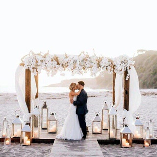 all white wedding arbor