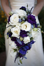 Deep purple and white cascading bridal bouquet weddings by anderson florist tillamook oregon