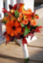 Fall bridal bouquet with rust and orange flowers weddings by andeson florist Tillamook