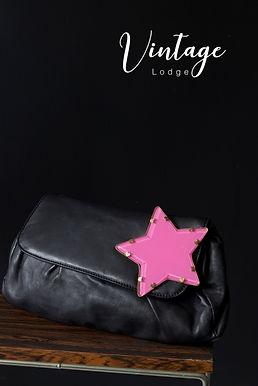 Rika clutch zwart met roze ster