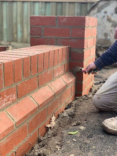 Photo of a bricklayer laying a front fence
