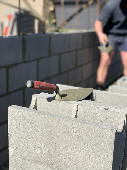 Photo of a bricklayer laying a block fence Hobart