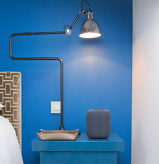 Photo of a bedside table and a lamp with