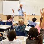 kids-raising-hands-class.jpeg