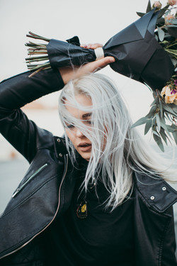 Canva - Woman Wears Black Leather Zip-up