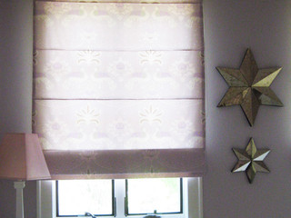 Custom Roman Shades are still a classic addition to any room...