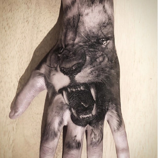 LION HAND BY THE CROOKED ROOK.jpg