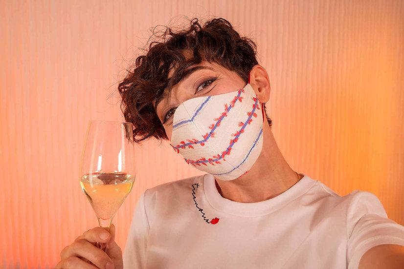 Mascherina protettiva fashion e double face in tessuto. Estiva, lavabile e riutilizzabile. Fatta a mano a Bologna.