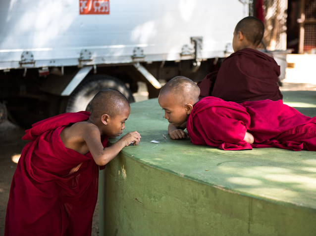 Young monks playing with paper in Bagan