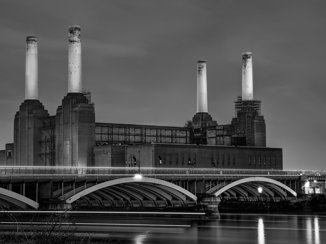 Trains speed past Battersea Power Station